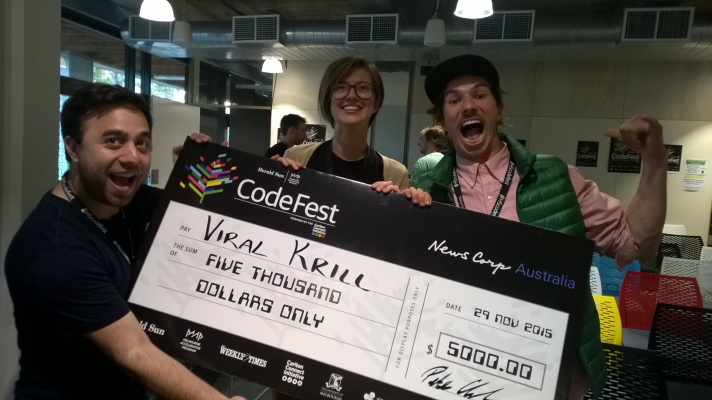 Viral Krill, with Leon from IBM celebrating with their novelty cheque